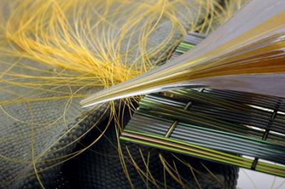 Et 'akustisk' fiber skal bane vejen for tøj, der både kan optage og afspille lyd og på den måde også opfange og monitorere signaler fra kroppen til medicinsk brug